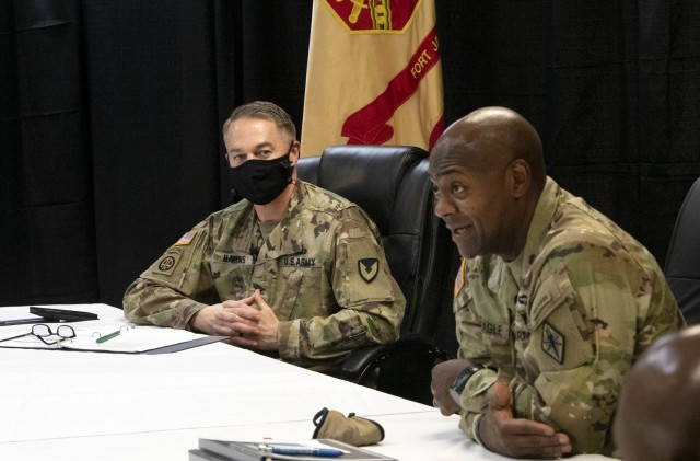 Col. John 'Wes' Hankins, Fort Jackson Garrison commander, watches as Brig. Gen. Milford H. 'Beags' Beagle Jr., post commander, speaks during a virtual Community Town Hall March 18. The community was provided with updates from installation offices and facilities. On-post housing officials stated the installation had the best response rate to a recent survey in 'the last couple years.'