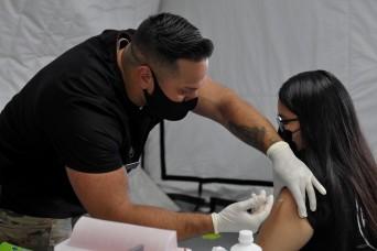 US Army Medics administer COVID-19 vaccines in Saipan