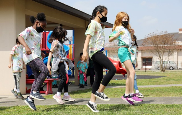 """From left, AnneGrace Meachem, Jazlynn Senders, Leila Kaea, Natalie Dalton and Andrea Crispell, all third-graders, perform the """"Jerusalema Dance"""" during the opening ceremony of the 2021 School Age Center Olympics at Sagamihara Family Housing Area, Japan, April 1."""