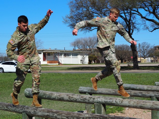 1st Lt. Nick Layden from 4th Squadron, and 1st Lt. Brian Billings from 2nd Squadron, 3rd Cavalry Regiment, used obstacle courses in Brave Rifles Country to train up for the Best Ranger Competition. They said that they were motivated by other Troopers training for competitions currently taking place within the Regiment. The contest runs from April 11-16 at Fort Benning, Georgia. (U.S. Army photo by Pfc. Johnathan Touhey)