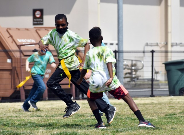 Deveyaun Meux-Mabon, left, a fifth-grader, and Donald Meachem, a sixth-grader, participate in the 2021 School Age Center Olympics at Sagamihara Family Housing Area, Japan, April 1.