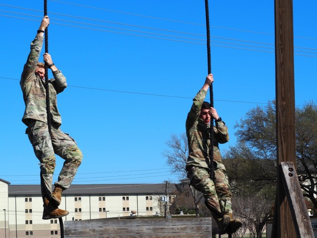 1st Lt. Brian Billings from 2nd Squadron and 1st Lt. Nick Layden from 4th Squadron, 3rd Cavalry Regiment, have ramped up training for the Best Ranger Competition. One day, they completed a nine-mile run, followed by an eight-mile ruck, and closed out the training with a 20-minute obstacle course workout. The competition runs from April 11-16 at Fort Benning, Georgia. (U.S. Army photo by Pfc. Johnathan Touhey)