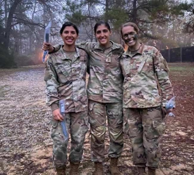 1st Lt. Maria Eggers (L) is seen here with two of her classmates during the Infantry Basic Officers Leaders Course at Fort Benning, Georgia.  After the culminating event, a 16-mile Foot March, they proudly received their Blue Infantry Chords. (U.S. Army Courtesy Photo)