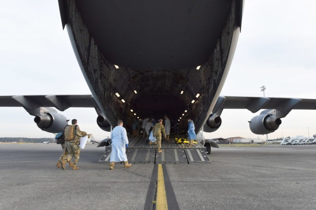 62 AW airlifts COVID-19 patient to Texas