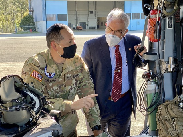 "Maj. Ralph Salazar, U.S. Air Ambulance Company, ""Cajun Dustoff,"" 1st Battalion, 5th Aviation Regiment commander, discusses equipment upgrades on the UH-60 Blackhawk helicopter and the operational tempo supporting the Joint Readiness Training Center and Fort Polk to J.M. (Jay) Harmon, U.S. Army Medical Center of Excellence deputy to the commanding general, March 26."