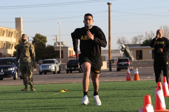 """Spc. Jorge Rivera-Jimenez, a Religious Affairs Specialist (56M) assigned to 69th Air Defense Artillery Brigade, runs through the """"sprint-drag-carry"""" event during the ACFT here at Fort Bliss, Texas."""