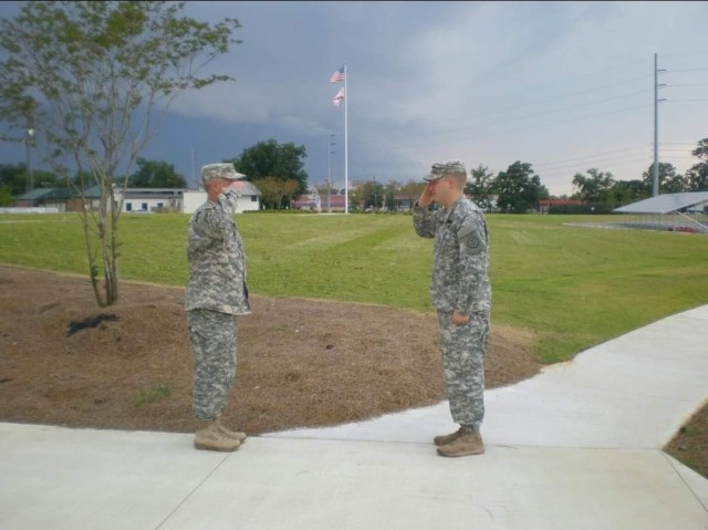 In 2017 Staff Sgt. John 'Jordan' Travis, domestic operations management support, emergency operations center, NCOIC, rendered the last salute to his father, Col. William 'Terry' Travis, before his retirement.  (Courtesy photo from family.)