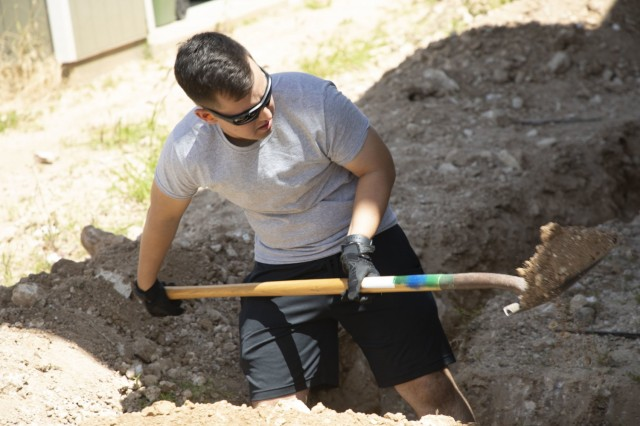 A soldier shovels dirt out of a trench at a Habitat for Humanity construction site. Soldiers from Alpha Company 209th Aviation Support Battalion volunteered to assist with the construction of a home being built in Kapolei.