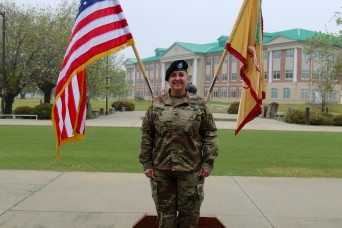 FEMALE BATTALION COMMANDER STANDS OUT AMONG THE RANKS