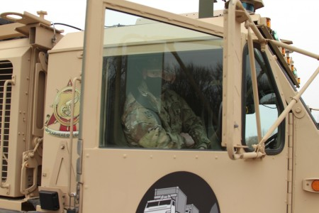 Maj. Gen. Darren Werner, Commanding General U.S. Army Tank-automotive and Armaments Command, prepares for a ride along in the Follower vehicle at a Leader – Follower demonstration on the Detroit Arsenal, Mich. Apr. 5.  The Follower vehicle is controlled by a robotic kit that will self-drive to keep speed and pace with the Leader vehicle.