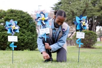 Camp Zama Girl Scouts plant pinwheels to raise child abuse awareness