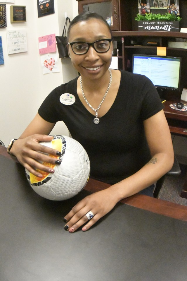 Tyneika Thomas, Fort Lee Youth Sports director, headed the Child and Youth Services effort to support the Installation Management Command's Virtual Soccer Kickoff Challenge that concluded April 6. The challenge aims to promote Month of the Military Child as well as break the Guinness World Records mark for the longest string of video soccer passes (photo by T. Anthony Bell).