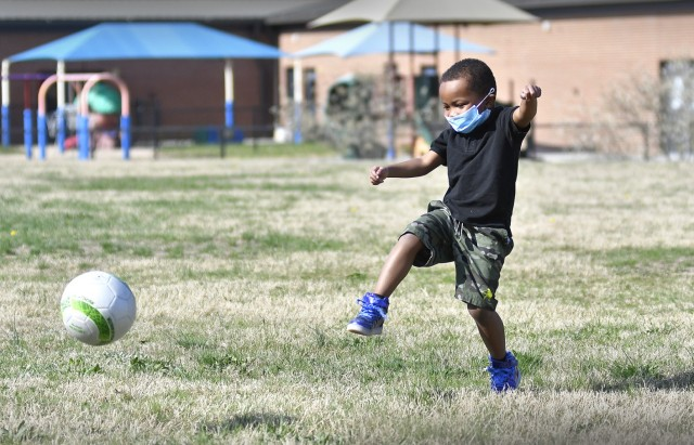 Isaiah Hubbard demonstrates kicking a soccer ball April 7 at the Child Development Center complex. His demonstration was similar to requirements for entering the Virtual Soccer Kickoff Challenge that concluded April 6 here. Seventy school-agers like the 5 year-old Hubbard joined the effort to break a Guinness World Records mark for the longest string of video soccer passes.  Hubbard belongs to the Strong Beginnings Pre-K program at the Yorktown CDC (Photo by T. Anthony Bell).