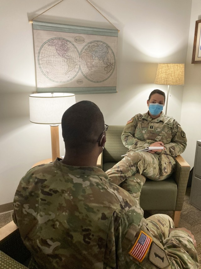 Captain Ioana Horotan, staff psychiatrist at Blanchfield Army Community, speaks with a Soldier about alcohol awareness. There are many resources available to Soldiers and Family members concerned about potential addiction or overusing alcohol.