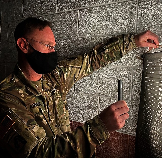 Chief Warrant Officer of the Military Intelligence Corps, Chief Warrant Officer 5 Aaron Anderson, was an integral member of Maj. Gen. Anthony R. Hale's team during their recent visit to the RAPID Escape Room at the 111th Military Intelligence Brigade on Fort Huachuca January 21, 2021. Maj. Gen. Anthony R. Hale, commander, U.S. Army Intelligence Center of Excellence has ordered all USAICoE units to take the first Friday of each month to foster team building, foster discussions, and complete training to get after the corrosives behaviors currently threatening the U.S. Army to include sexual assault, sexual harassment, suicide, racism and extremism. (U.S. Army photo by Meredith Mingledorff)