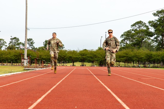 U.S. Army 1st Lt. David Stanley and 1st Lt. Zachary Hobson, both infantry officers assigned to 1st Armored Brigade Combat Team, 3rd Infantry Division, sprint 100 meters after completing a 24-mile ruck, April 9, 2021, on Fort Stewart, Georgia. Both Soldiers, who were deployed in South Korea, traveled to Georgia to participate in the upcoming Best Ranger Competition slated to take place at Fort Benning, Georgia, April 16-18. (U.S. Army photo by Pfc. Summer Keiser)
