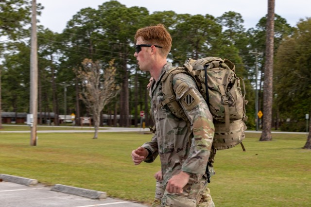 U.S. Army 1st Lt. Zachary Hobson, a mortar platoon leader assigned to 1st Armored Brigade Combat Team, 3rd Infantry Division, finishes a 24-mile ruck march with his training partner, April 9, 2021, on Fort Stewart, Georgia. Hobson and his training partner are currently deployed in South Korea and have returned to the United States to participate in the 2021 Best Ranger Competition slated to take place at Fort Benning, Georgia, April 16-18. (U.S. Army photo by Pfc. Summer Keiser)