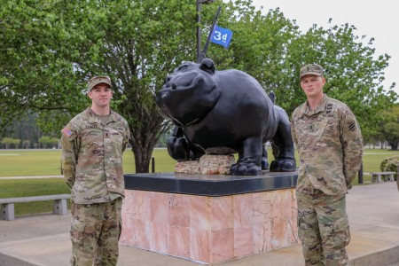 U.S. Army 1st Lt. David Stanley and 1st. Lt. Zachary Hobson, both infantry officers assigned to 1st Armored Brigade Combat Team, 3rd Infantry Division, pose by 3rd ID's Rocky statue, March 31, 2021, on Fort Stewart, Georgia. Both Soldiers are currently training for the 37th Annual Best Ranger Competition slated to take place April 16-18 at Fort Benning, Georgia. (U.S. Army photo by Pfc. Summer Keiser)