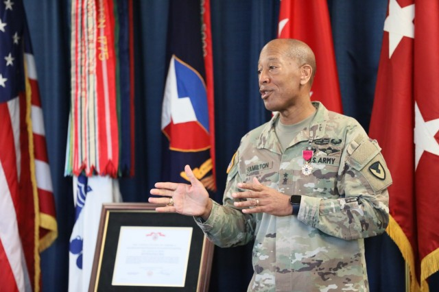Maj. Gen. Charles Hamilton thanks his team during his farewell and award ceremony. Hamilton spent the last nine months as AMC's deputy chief of staff for logistics and operations, G-3, and will now serve as the Army G-4 assistant deputy chief of staff. (U.S. Army photo by Samantha Tyler)