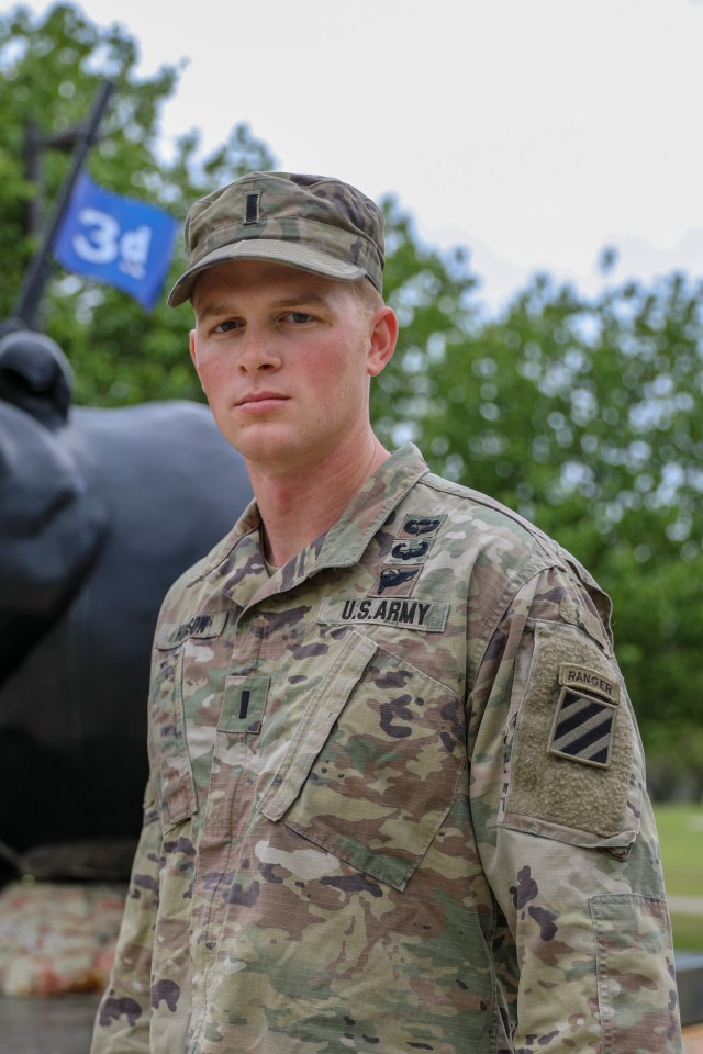 U.S. Army 1st Lt. Zachary Hobson, a mortar platoon leader assigned to 1st Armored Brigade Combat Team, 3rd Infantry Division, poses by 3rd ID's Rocky statue, March 31, 2021, on Fort Stewart, Georgia. Hobson and his training partner departed from Camp Casey, South Korea, earlier this year to participate in the upcoming Best Ranger Competition slated to take place at Fort Benning, Georgia, April 16 through 18. (U.S. Army photo by Pfc. Summer Keiser)