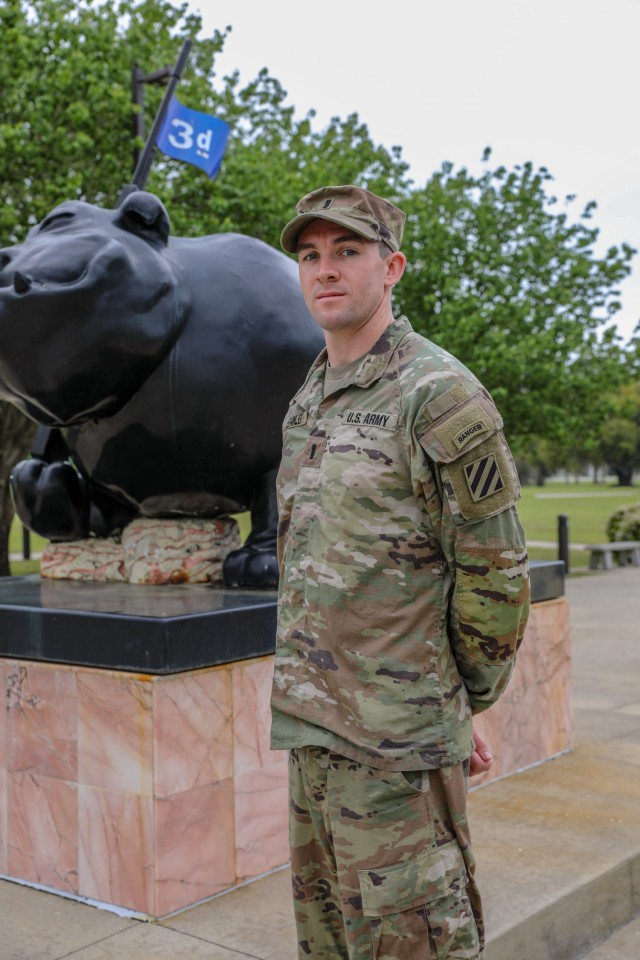 U.S. Army 1st Lt. David Stanley, a tank company executive officer assigned to 1st Armored Brigade Combat Team, 3rd Infantry Division, poses next to 3rd ID's Rocky statue, March 31, 2021, on Fort Stewart, Georgia. Stanley and his training partner departed from Camp Casey, South Korea, earlier this year to participate in the upcoming Best Ranger Competition slated to take place at Fort Benning, Georgia, April 16-18. (U.S. Army photo by Pfc. Summer Keiser)