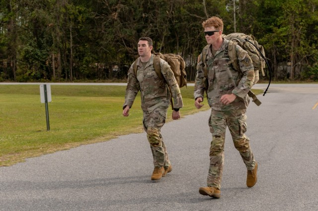 U.S. Army 1st Lt. David Stanley and 1st Lt. Zachary Hobson, both infantry officers assigned to 1st Armored Brigade Combat Team, 3rd Infantry Division, sprint to finish a 24-mile ruck march, April 9, 2021, on Fort Stewart, Georgia. Both lieutenants, who were deployed in South Korea, traveled to Georgia to participate in the Best Ranger Competition, slated to take place April 16-18 at Fort Benning, Georgia, and are in team 3 of the competition.  (U.S. Army photo by Pfc. Summer Keiser)