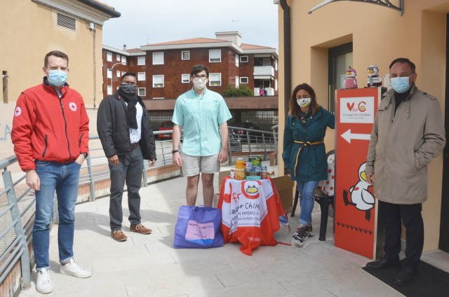 "VICENZA, Italy - American students enrolled in the Child and Youth Services Keystone Club donate food items to ""Vicenza for Children"", a non-profit organization the garrison is partnered with in the town of Marola April 7, 2021. In the picture, (from left to right) Pierandrea Turchetti, Vicenza Red Cross president, Davisen Poorcelan, CYS youth program director, Keystone Club Treasurer, ninth-grader Charlie Cottle, Coralba Scarrico, ""Vicenza for Children"" president and Matteo Tosetto, Vicenza's city councilman for social services, family, integration policies and voluntary associations.