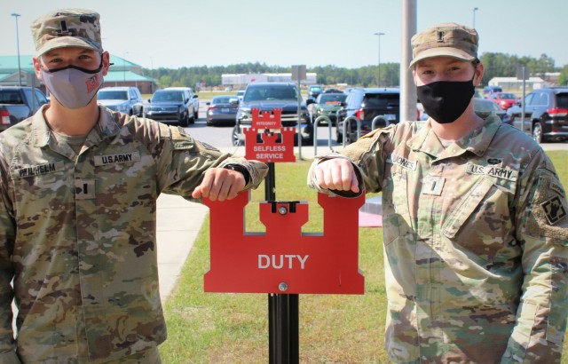 U.S Army 1st Lt. Andrew Wilhelm and 1st Lt. Madison Jones, both assigned to 92nd Engineer Battalion, pose in front of Army Values signs on Fort Stewart, Georgia, April 7, 2021. These lieutenants are slated to compete in the Army's Best Sapper Competition on Fort Leonard Wood, Missouri, May 1-3, 2021.