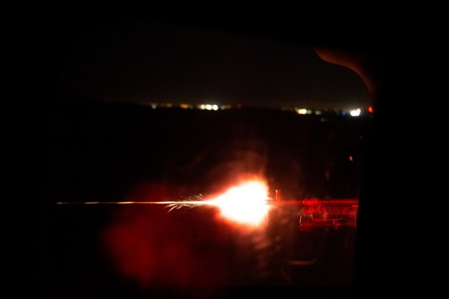 Sgt. Christopher Armenta with C Company, 1st Assault Helicopter Battalion, 140th Aviation Regiment, Washington National Guard, fires an M240H machine gun during aerial gunnery qualifications night fire at Fort Sill, Oklahoma, March 30, 2021.