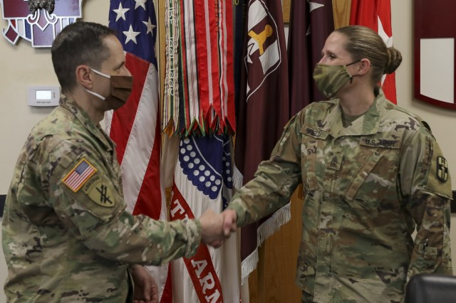 U.S. Army Sgt. Maj. Christie Fields , 807th MC(DS) Acting Command Sergeant Major, receives a challenge coin from Brig. Gen. Stephen Iacovelli, 94th TD Commanding General, April 8, 2021 at Fort Douglas, Utah. (U.S. Army Reserve photo by Spc. Ronald D. Bell)