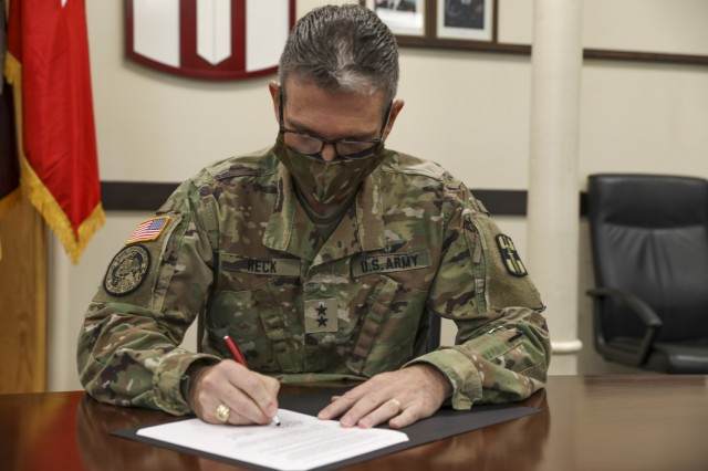 U.S. Army Reserve Maj. Gen. Joe Heck, 807th MC(DS) Commanding General, signs a Memorandum of Understanding instituting the Visiting Adjunct Instructor Program (VAIP), April 8, 2021 at Fort Douglas, Utah. (U.S. Army Reserve photo by Spc. Ronald D. Bell)