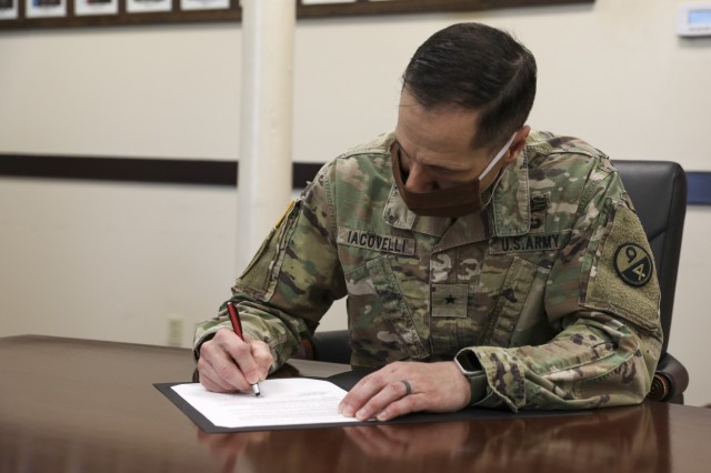 U.S. Army Brig. Gen. Stephen Iacovelli, 94th TD Commanding General, sign a Memorandum of Understanding instituting the Visiting Adjunct Instructor Program (VAIP), April 8, 2021 at Fort Douglas, Utah. (U.S. Army Reserve photo by Spc. Ronald D. Bell)