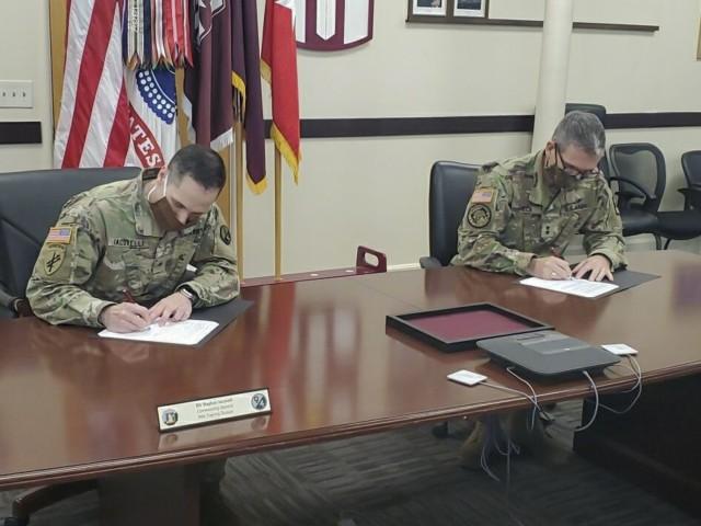 U.S. Army Maj. Gen. Joe Heck, 807th MC(DS) Commanding General, and  Brig. Gen. Stephen Iacovelli, 94th TD Commanding General, sign a Memorandum of Understanding instituting the Visiting Adjunct Instructor Program (VAIP), April 8, 2021, Fort Douglas, Utah. (U.S. Army Reserve photo by Maj. Sherrain Reber)