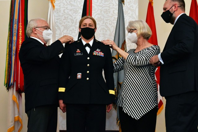 U.S. Army Brig. Gen. Heidi J. Hoyle, the commanding general of Military Surface Deployment and Distribution Command, has her promotion to major general stars pinned on by her parents and husband during a ceremony in her honor at the event center at Scott Air Force Base, Ill. April 9, 2021.
