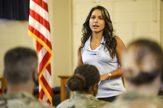 Hawaii Congresswoman and Hawaii Army National Guard Major Tulsi Gabbard speaks to U.S. Army Soldiers on April 8, 2021 during 2nd Infantry Brigade Combat Team, 25th Infantry Division's women's mentorship program at Schofield Barracks, Hawaii. Warrior Sisters-in-Arms, a People First initiative, is a monthly conference that seeks to provide female Soldiers an environment to share stories and challenges unique to women serving in the Army. (U.S. Army photo by MAJ James Sheehan)