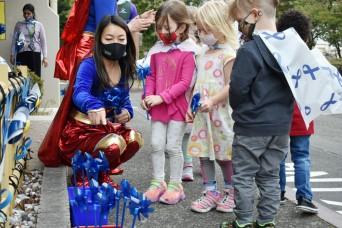 Camp Zama MWR honors military children with superhero parade, pinwheel planting