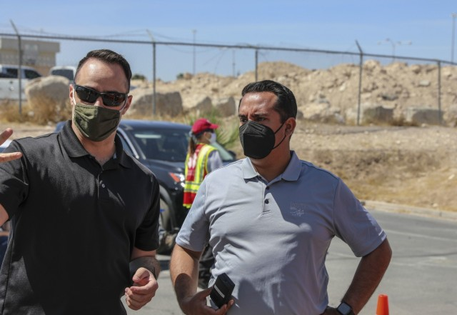 Health and Human Services Director Fabian Solis (right) speaks with Sgt. Daniel Sheahan with Joint Task Force 17 about operations at the mobile vaccination unit site, Tuesday, April 6, 2021 at the Paiute Indian Tribe in Las Vegas, Nevada.