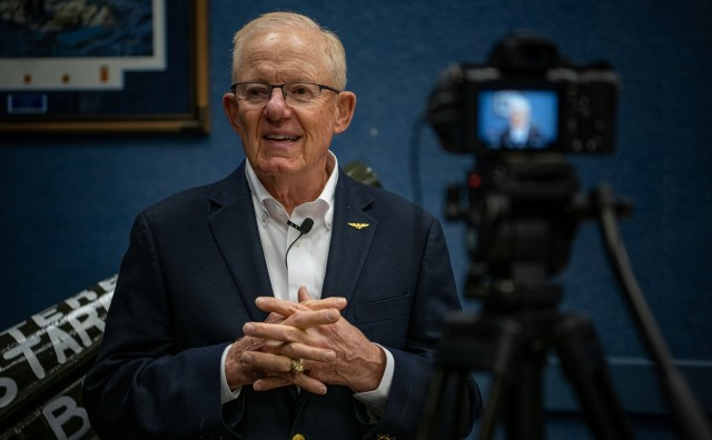 Retired Navy Capt. Charlie Plumb answers a question posed by reporter Dani Carson of Oklahoma Life TV. Plumb has shared his message of hope and resiliency with over 5,000 audiences in government, business, media, and other organizations.