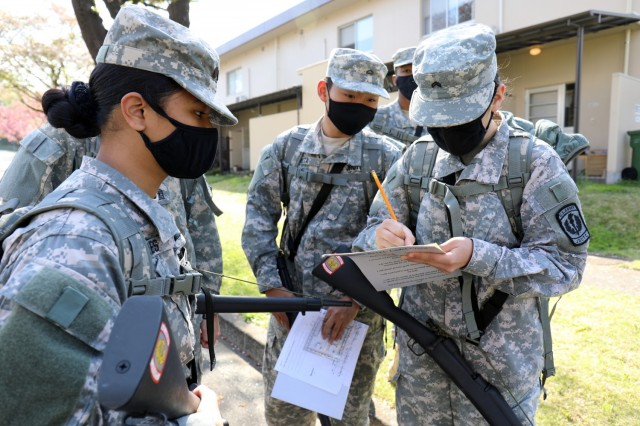 Cadets work on the orienteering portion of the Zama Middle High School Junior Reserve Officers' Training Corps Cadet Leadership Challenge at Camp Zama, Japan, April 7.