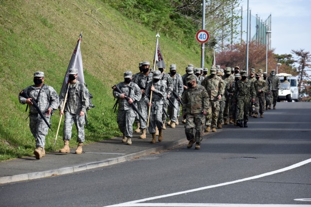 Members of the Zama Middle High School Junior Reserve Officers' Training Corps participate in a nearly 3-mile road march during the organization's Cadet Leadership Challenge at Camp Zama, Japan, April 6.