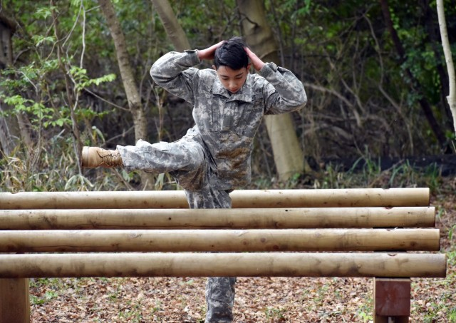 Cadet Pvt. Vincent Carlo completes the obstacle course during the Zama Middle High School Junior Reserve Officers' Training Corps Cadet Leadership Challenge at Camp Zama, Japan, April 6.