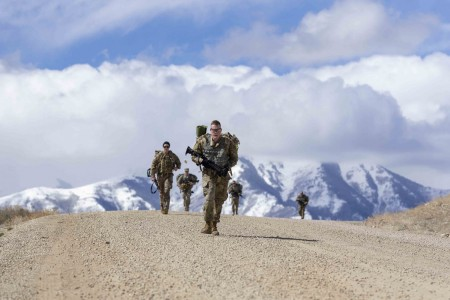 Soldiers participate in a six-mile ruck march during the Utah National Guard Best Warrior Competition at Camp Williams, Utah, March 23, 2021.