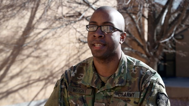 Spc. Byron Wright, a satellite communications operator and maintainer, (25 Sierra military occupational specialty) with the Army Reserves' 2nd Space Battalion, talks about his military career at Fort Carson, Colorado. (U.S. Army photo by Staff Sgt. Dennis Deprisco)
