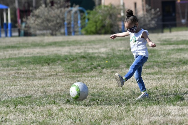 Izabelle Riley of the Yorktown Child Development Center kicks a ball during soccer drills April 7 during a functional fitness class. The instruction is intended to instill healthy exercise habits in young children.