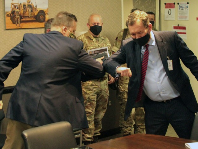 Michael Cadieux, Director Ground Vehicle Systems Center (left), greets Chris Bushell (right), Director General Land for U.K. Ministry of Defence, at the Detroit Arsenal, Michigan Apr. 13, in what has become the acceptable greeting during the COVID-19 pandemic .  The two met to give Bushell an overview of operations at GVSC.