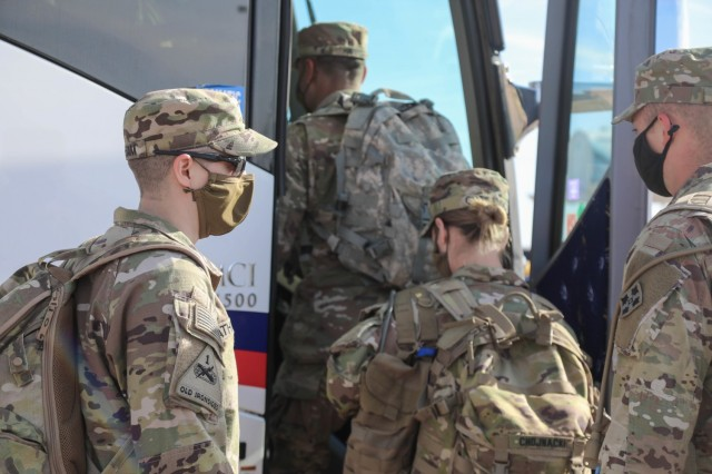 U.S. Army Soldiers assigned to 2nd Brigade, 4th Infantry Division, based at Fort Carson, Colorado, board buses to deploy to the Pueblo Community Vaccination Site in Pueblo, Colorado, April 11, 2021. U.S. Northern Command, through U.S. Army North, remains committed to providing continued, flexible Department of Defense support to the Federal Emergency Management Agency as part of the whole-of-government response to COVID-19. (U.S. Army photo by Capt. Jason Elmore)