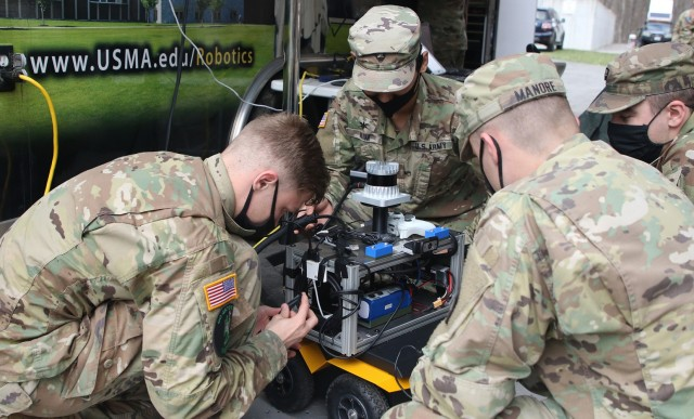 U.S. Military Academy cadets, as part of their capstone project working with unmanned systems, make last-second adjustments to an Unmanned Ground Vehicle (UGV/Jackal) during the Human-Robot Teaming — Competition (HuRT-C) on Saturday at West Point. The HuRT-C project's purpose is to develop manned-unmanned teams (MUMT) capable of conducting reconnaissance and providing direct fire support to improve the combat effectiveness of a squad-sized element.