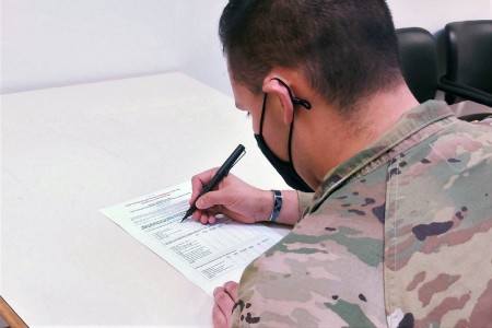 A Soldier fills out the Army Family Housing Tenant Satisfaction Survey Dec. 10, 2020. Results from the survey showed that overall customer satisfaction is improving, senior Army housing officials said, as the service continues to improve on-base living conditions.