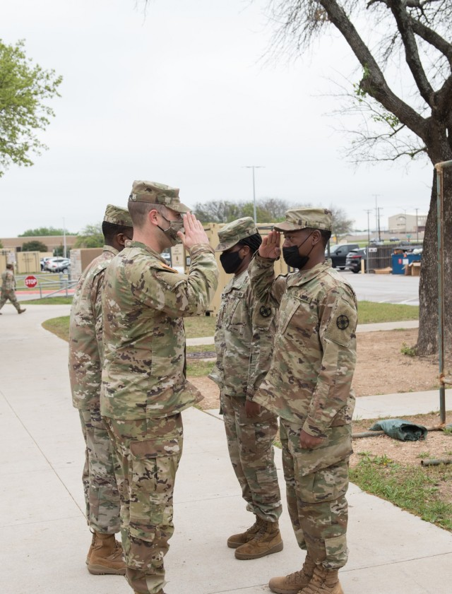 Bishopville, South Carolina native, Pvt. Montrez Wright, 61st Quartermaster Battalion, receives his unit patch April 15.  Leaders from the 13th Expeditionary Sustainment Command began the inaugural Green Company cycle April 6-14. (U.S. Army photo by Sgt. 1st Class Kelvin Ringold)