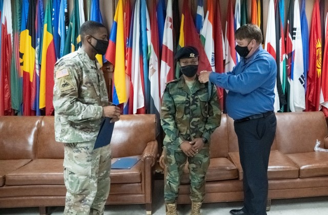 LT Agatha Kpamina, Ghana Armed Forces, is the first female from one of U.S. Africa Command's partners – Ghana – to attend and complete the Infantry Basic Officer Course at Fort Benning, Georgia. Mark Irish, chief of the Maneuver Center of Excellence's International Military Student Office presents the Infantry blue cord to Kpamina.  Capt. Jordan Hill, C Company commander, 3rd Battalion, 81st Armor Battalion, 199th Infantry Brigade, presented the Foreign Military Badge that can be worn on her official uniform.